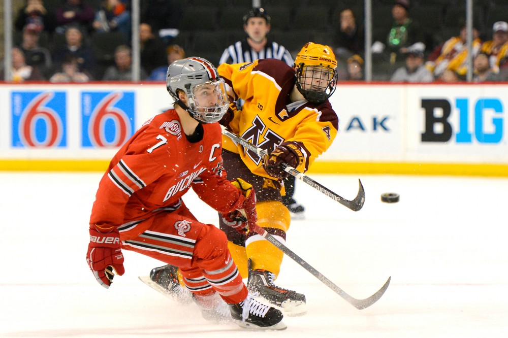 Gophers defender Steve Johnson passes the puck down the ice while playing against Ohio State in the Xcel Energy Center on Friday night. Following their 4-2 victory over Ohio State, the Gophers fell to Michigan 5-3 the following night, leaving the 2016 Big Ten Tournament.