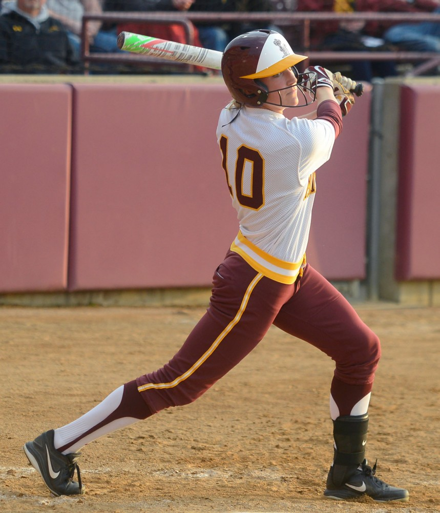 Senior utility Paige Palkovitch swings at a pitch against Purdue at Jane Sage Cowles Stadium on May 1.