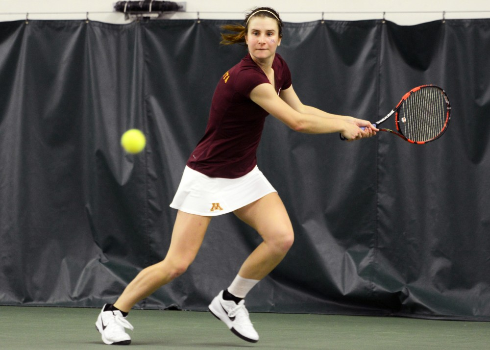 Sophomore Caroline Ryba prepares to return the ball to Penn State in the Baseline Tennis Center Friday, March 18.