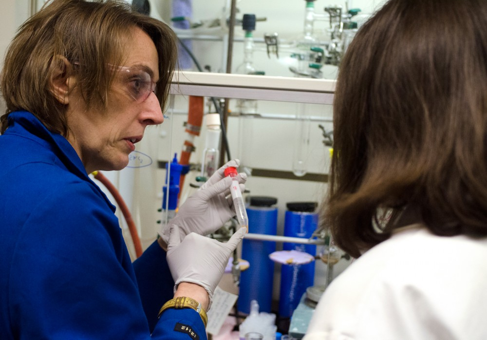 Post doctoral associate Slyvie Pailloux displays a result to chemistry professor Valerie Pierre in their research lab in Kolthoff hall Friday. The research team is working on creating a new test for bacterial infections that would provide results much quicker.