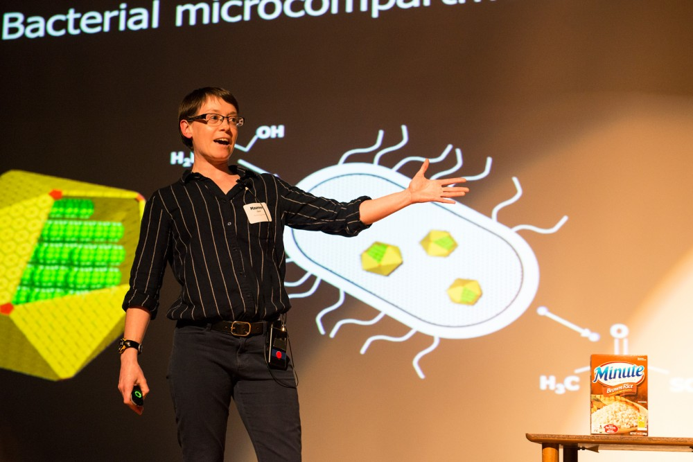 Research assistant professor of the Schmidt-Dannert lab, Maureen Quin, gives a five minute talk on her enzymes research during the SciSpark 2016: Women in Science event in the St. Paul Student Center on Monday evening.