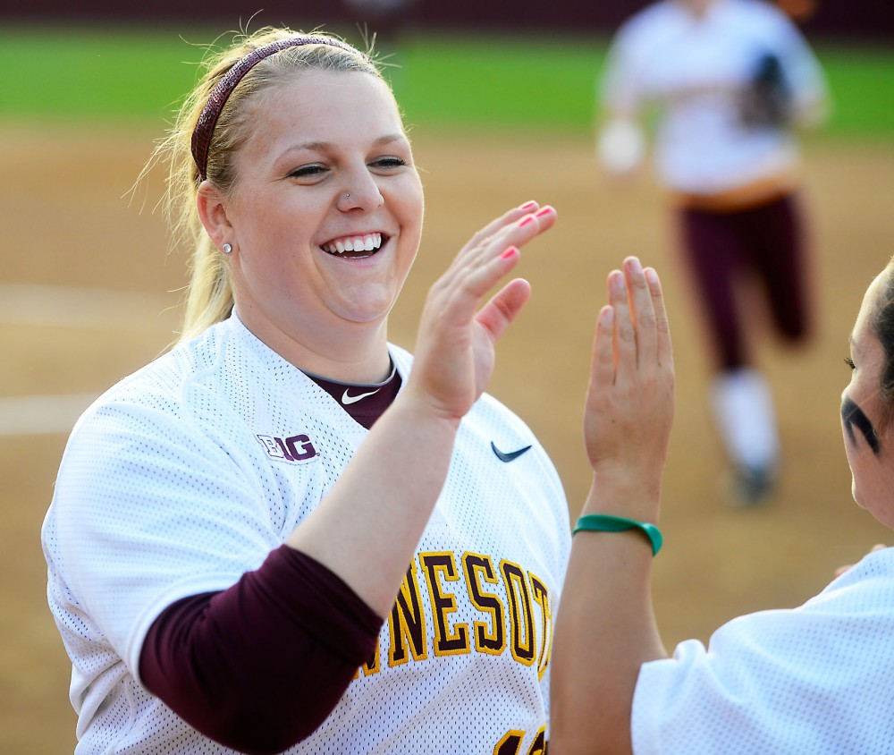 Sara Groenewegen high-fives her teammates while returning to the dugout at the Jane Sage Cowles Stadium on May 5, 2015.