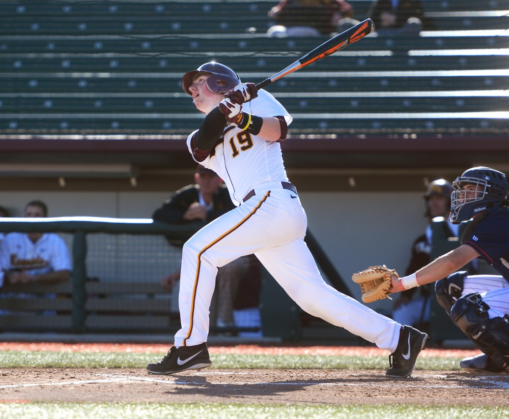 Gophers catcher Austin Athmann swings at a pitch at Siebert Field on Mar. 31, 2015.