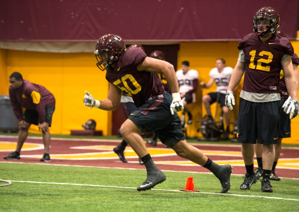 Linebacker Jack Lynn runs a drill during the Gophers spring practice on Thursday afternoon.