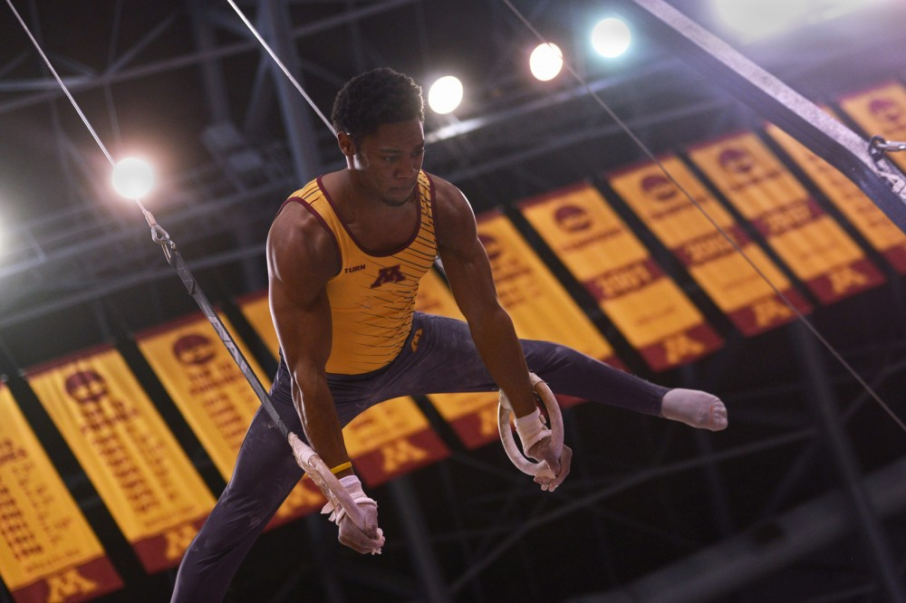 Senior Paul Montague, Jr. competes during the still rings event at the Sports Pavilion on Jan. 30.