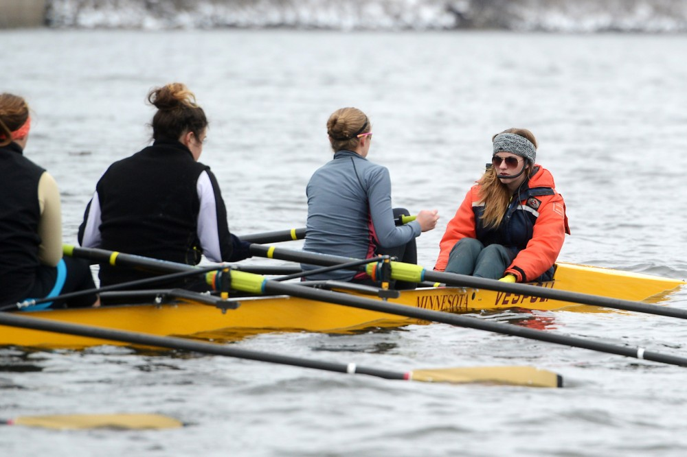 Coxswain Taylor Gainey coordinates and guides the boat at a rowing team practice on the Mississippi River on March 23, 2015.