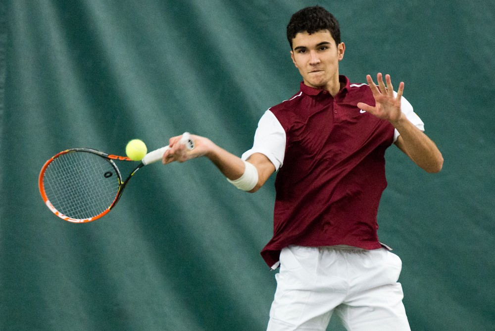 Freshman Josip Krstanovic hits the ball during the Gophers' first home event of the spring season at Baseline Tennis Center on Jan. 16.