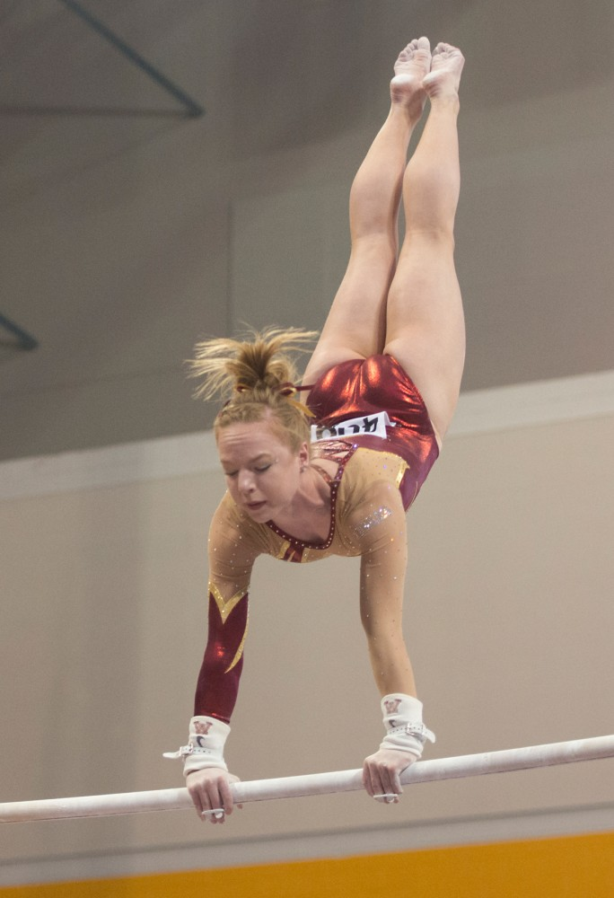 Senior Lindsay Mable competes on the uneven bars at the NCAA Women's Gymnastics Regional at the Sports Pavilion on Saturday. The Gophers placed second and will be advancing to the Championships in Fort Worth, Texas.