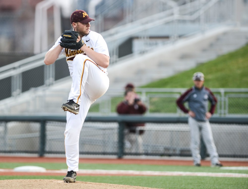 Minnesota starter Tyler Hanson pitches against Augsburg at Siebert Field on May 6, 2014.