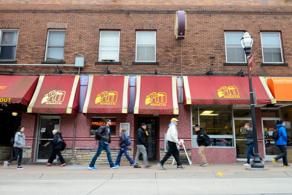 Pedestrians pass by the Big 10 Restaurant and Bar on Washington Avenue in Stadium Village on Wednesday afternoon. Big 10 sits on the site of a proposed apartment complex.