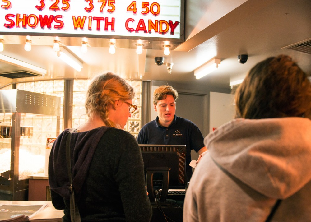 University alumnus Brady Knudson sells movie tickets at the St. Anthony Main Theatre on Tuesday night. The theatre is one of the venues hosting the 35th annual Minneapolis-St. Paul International Film Festival from April 7-23.
