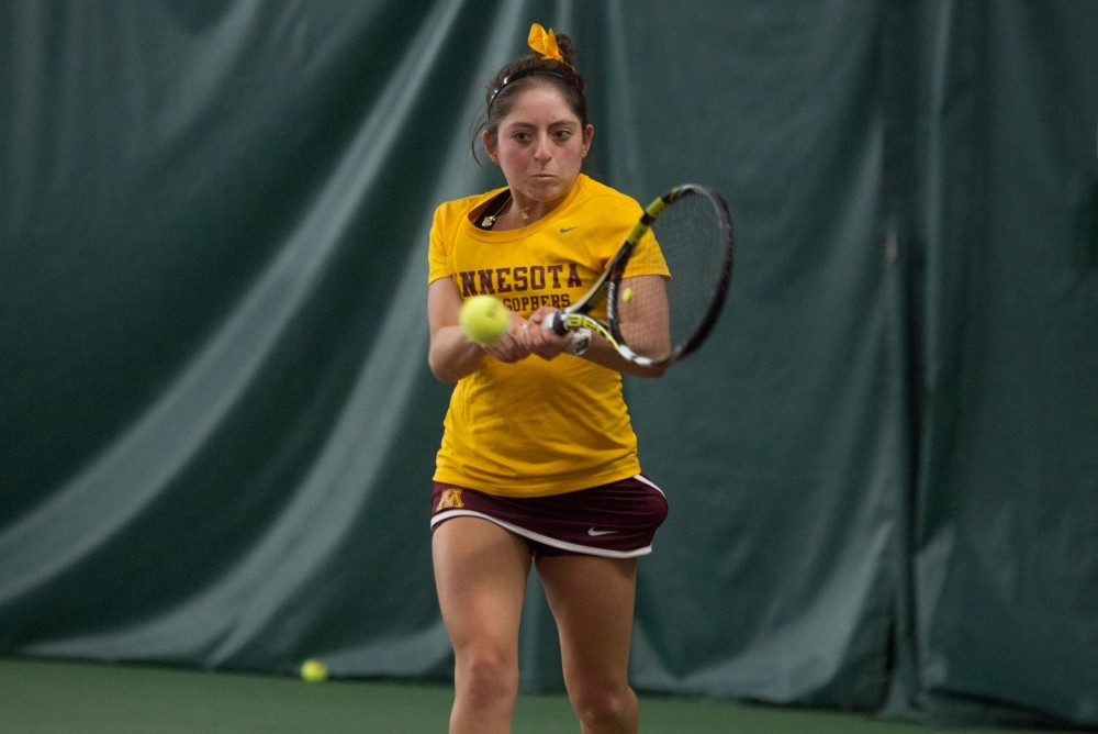 Camila Vargas Gomez returns a shot during a match against Michigan State University on April 1 at Baseline Tennis Center where the Gophers defeated Michigan State, 5-2.