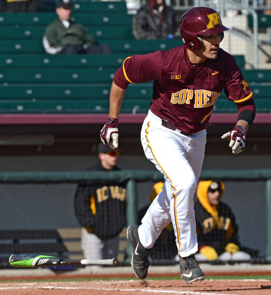 Gophers infielder Micah Coffey runs to first at Siebert Field on Apr. 1.