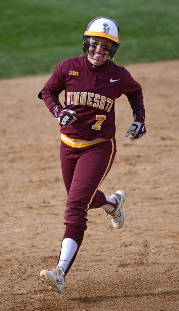 Sam Macken is all smiles as she rounds the bases after hitting a home run during Saturday's  home opener double header against Illinois at Jane Sage Cowles Stadium. The Gophers won 6-5.