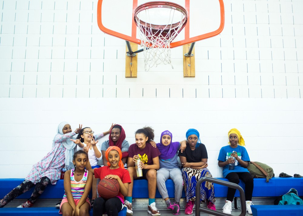 Members of the Cedar-Riverside community's sixth grade girls basketball team pose for a picture at Brian Coyle Center on Friday. The team, which is made up of 10 girls from the area, was gifted uniforms that were co-designed with a professor and grad students at the University's college of design to be more culturally appropriate.