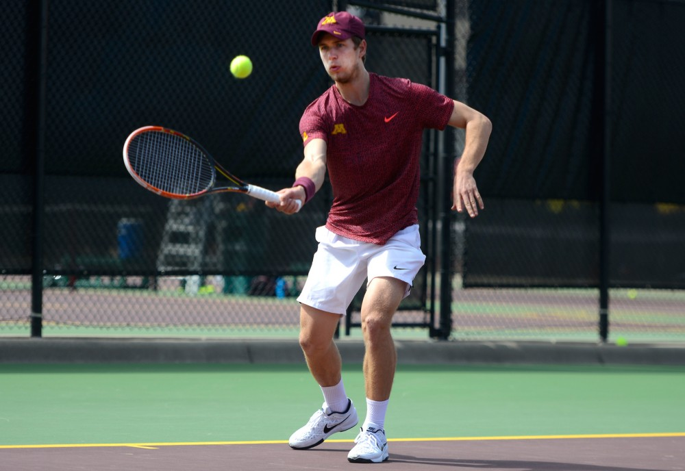 Sophomore Matic Spec competes against Michigan State in a singles match at the Baseline Tennis Center on April 10.