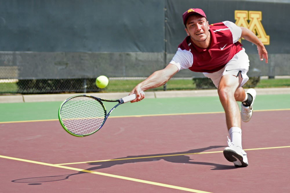Freshman Justyn Levin returns the ball to Penn State Sunday afternoon at Baseline Tennis Center. Levin's singles match win helped the Gophers win 4-3 over Penn State.