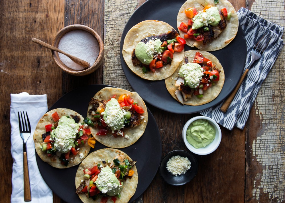 Ancho-rubbed walleye filets on corn tortillas topped with pico de gallo, avocado crema, and cotija cheese.