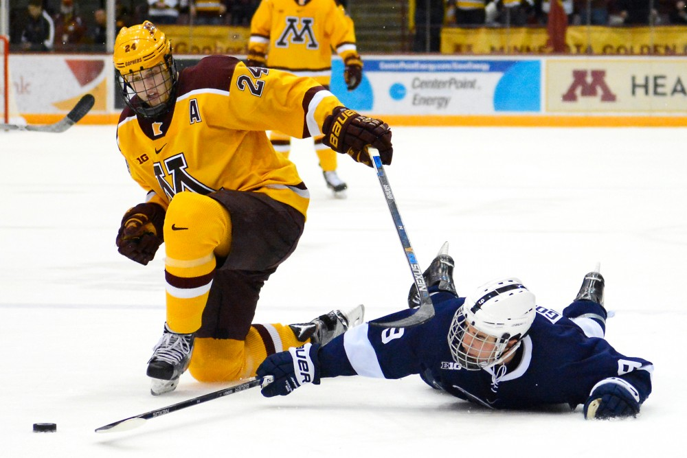 Gophers forward Hudson Fasching fights to maintain control of the puck against Penn State in Mariucci Arena on Feb. 6.
