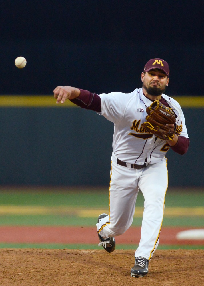 Redshirt senior Ty McDevitt pitches the ball at Siebert Field on Tuesday, April 19 where the Gophers took on North Dakota State.