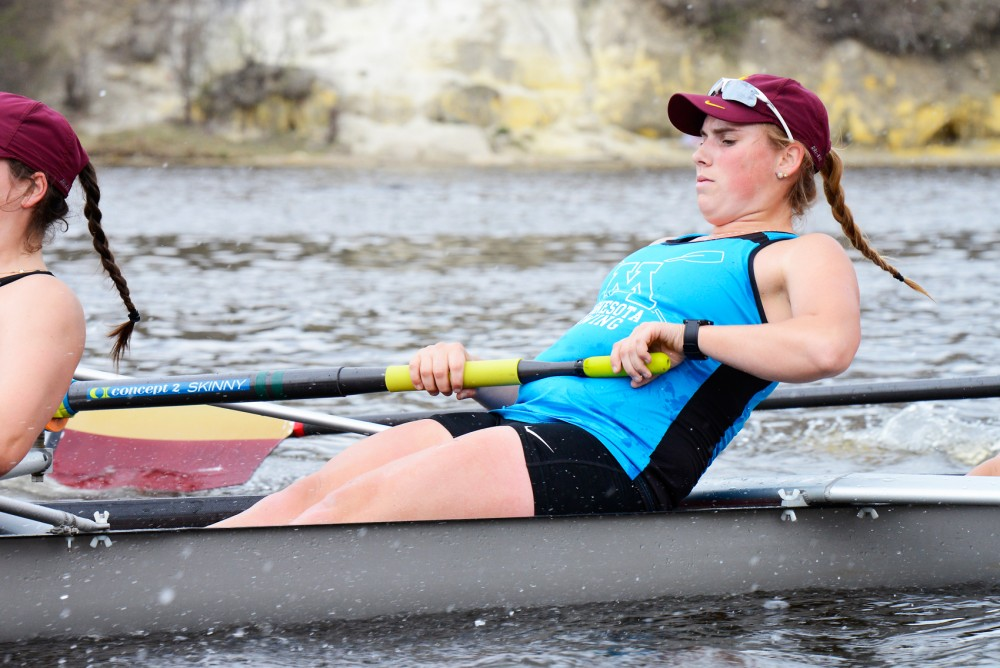 Junior Anna Greene rows during the Universitys team practice on the Mississippi River on Monday afternoon.