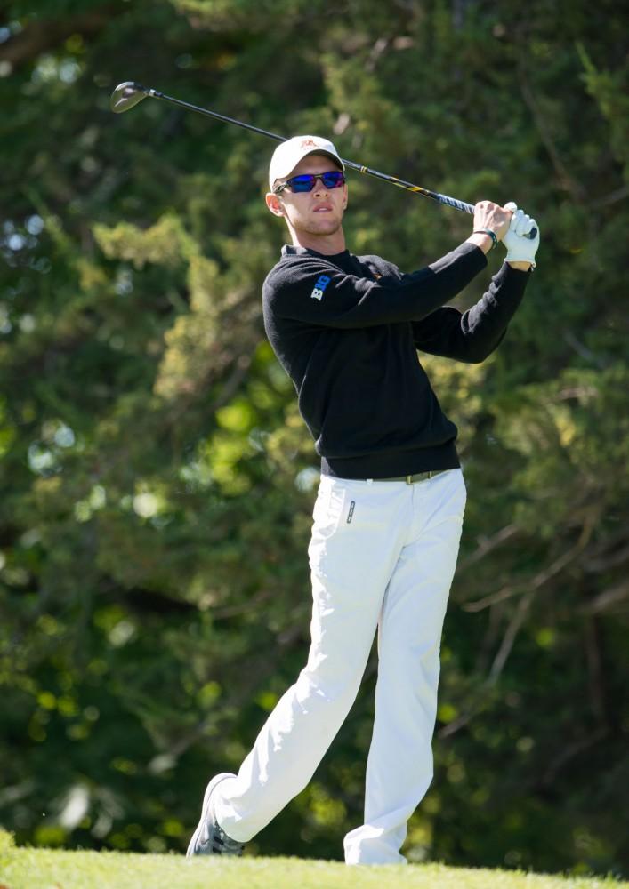 Senior Jon Dutoit drives the ball at the Windsong Golf Club on Sept. 13, 2015.