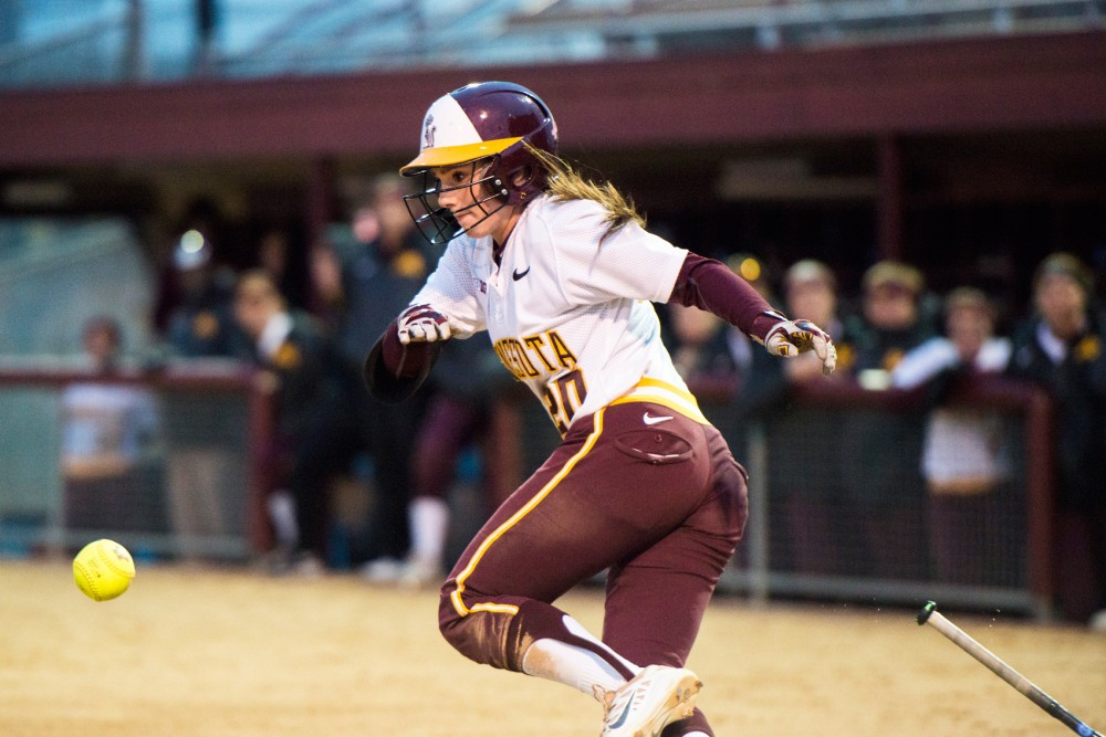 Freshman Maddie Houlihan throws her bat after a base hit against Wisconsin on Apr. 12 at Jane Sage Cowles Stadium.