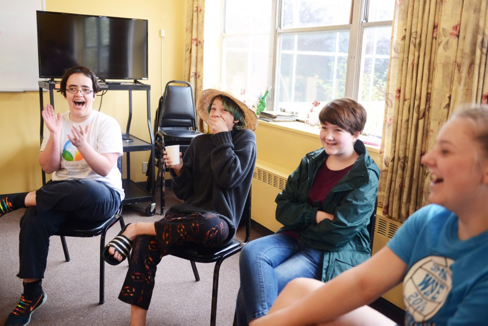 Students in a sexual education program at the First Unitarian Society in Minneapolis laugh while participating in an activity.