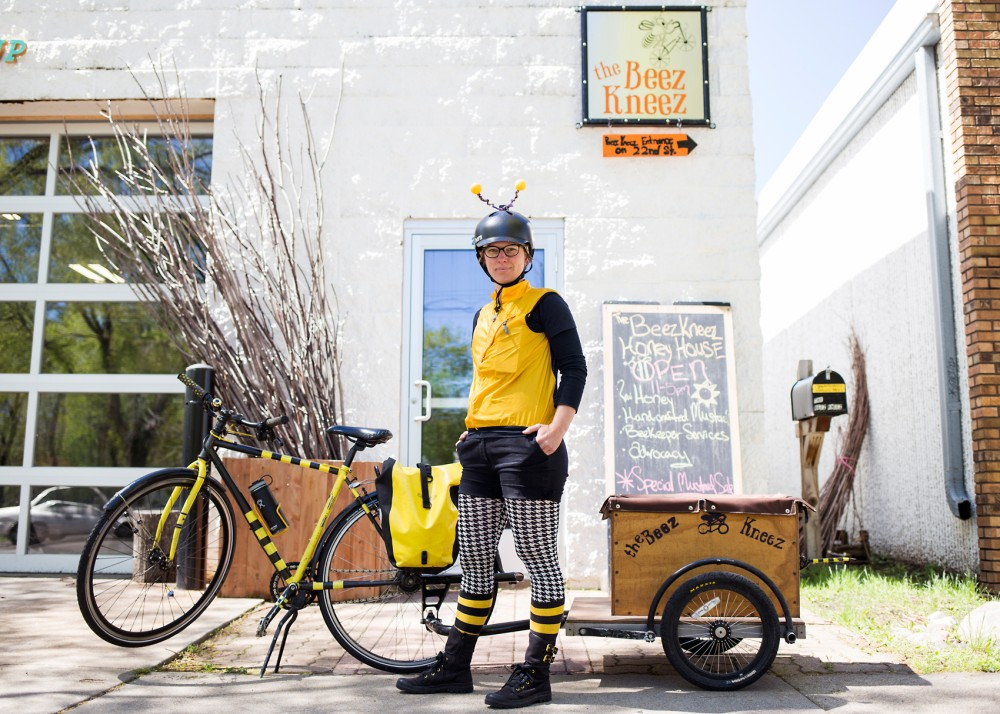 Suited up to resemble a bee, founder and beekeeper Kristy Lynn Allen poses for a portrait outside of The Beez Kneez in Minneapolis on Friday. In addition to the LLC's efforts to educate the public about beekeeping in the Twin Cities, Allen delivers both honey and live bees throughout the community via her bicycle.