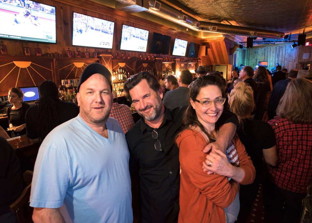 Viking Bar owners Patrick Johnston, Aaron Britt and Amy Britt pose for a portrait in their Cedar Riverside bar on the evening of May 28. The Viking Bar reopened under new management on May 25 after closing its doors 10 years ago.