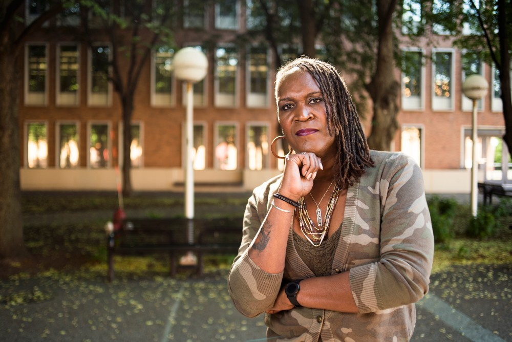 Andrea Jenkins, a former Minneapolis city council policy aide and Transgender Oral History Project curator, poses for a portrait outside Blegen Hall on the West Bank campus, June 2.