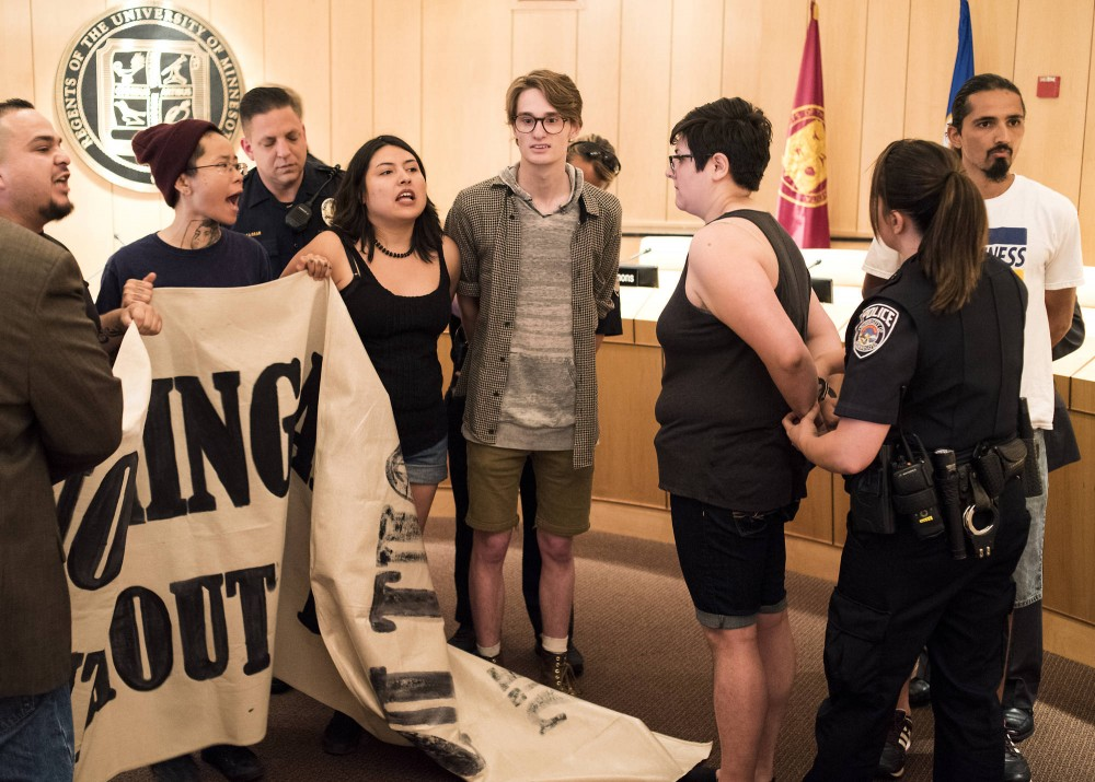 Six students are arrested by UMPD for protesting during the Board of Regents meeting in the McNamara Alumni Center on Friday, June 10. The individuals were a part of a larger group of about 30, who gathered in demonstration to voice their opposition to tuition hikes.