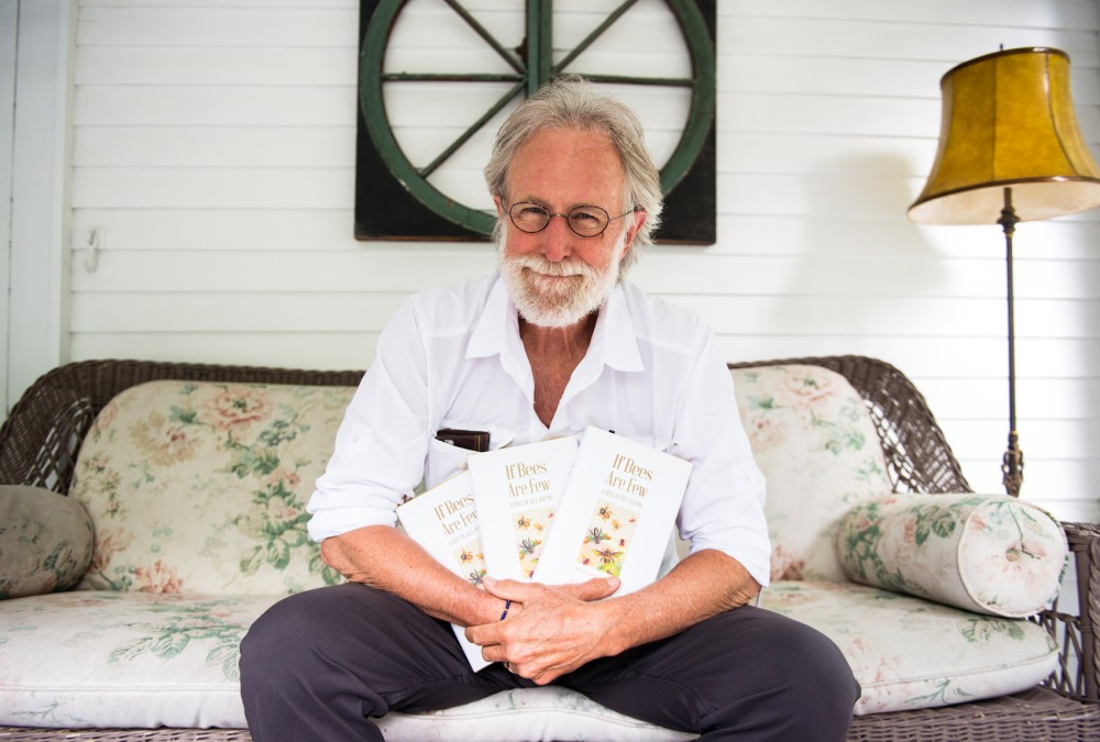 Former Star Tribune editorialist Jim Lenfestey poses with copies of his anthology of bee-related poems at his home on Monday. The anthology, titled If Bees Are Few, was published with the University of Minnesota Press, and all proceeds will be donated to the Universitys Bee Lab.