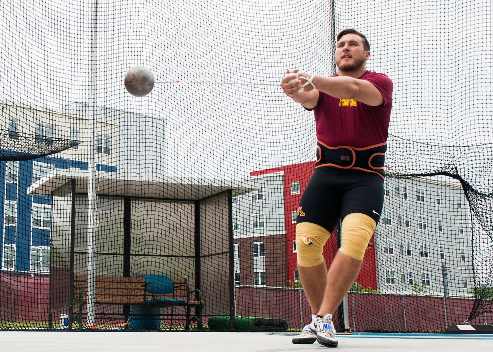 Senior Sean Donnelly practices the hammer throw at an outdoor practice field on June 4.