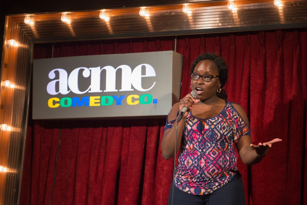 Stand-up comedian Charms performs at Acme Comedy Companys open mic on Monday night. The club could face closure due to an apartment development that would eliminate a majority of the parking spaces in the lot across from Acme.