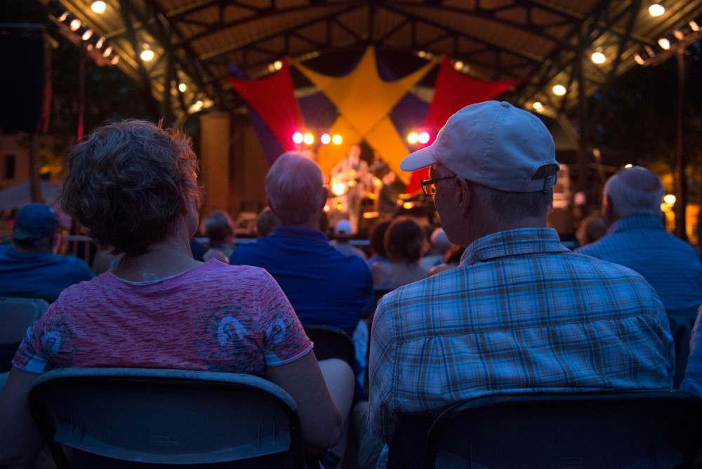 Attendees of Twin Cities Jazz Festival watch the final act of the weekend, the John Pizzarelli Quartet, preform at the main stage at Mears Park in downtown St. Paul on Saturday.