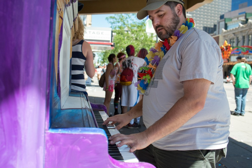 Matthew Stoffel plays on a public piano outside of the Brave New Workshop Comedy Theatre in Minneapolis after the Twin Cities Pride Parade on June 26. Stoffel has been playing piano since he was 3 years old.