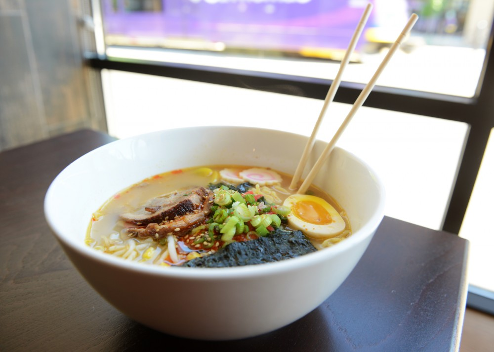A bowl of Karai Miso ramen sits on a table at Ippindo Ramen House, which recently opened on Washington Avenue. The restaurant serves traditional Japanese dishes.