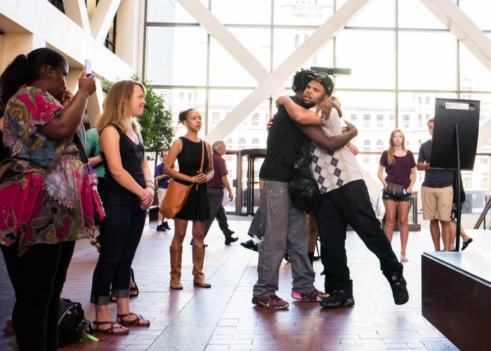 Devonne Mayweather, right, embraces Wesley Martin at the Hennepin County Government Center in Minneapolis on June 6. Black Lives Matter Minneapolis and other supporters joined Martin, who was shot by Allen