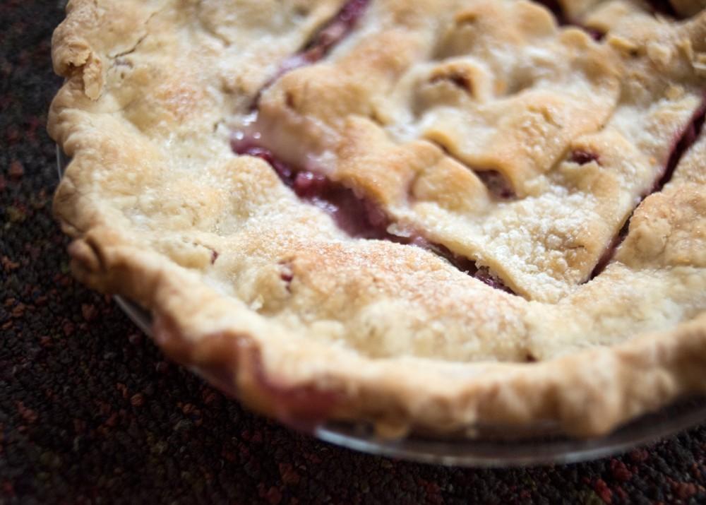 Refreshing rhubarb pie is a fun treat to make with friends using in seasonal ingredients.