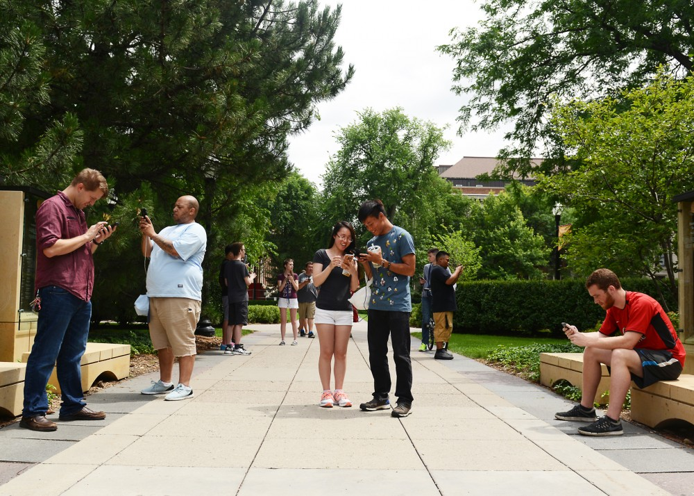 People could be seen wandering campus capturing Pokemon on their phones during a University of Minnesota Pokemon Go meet up on Sunday.