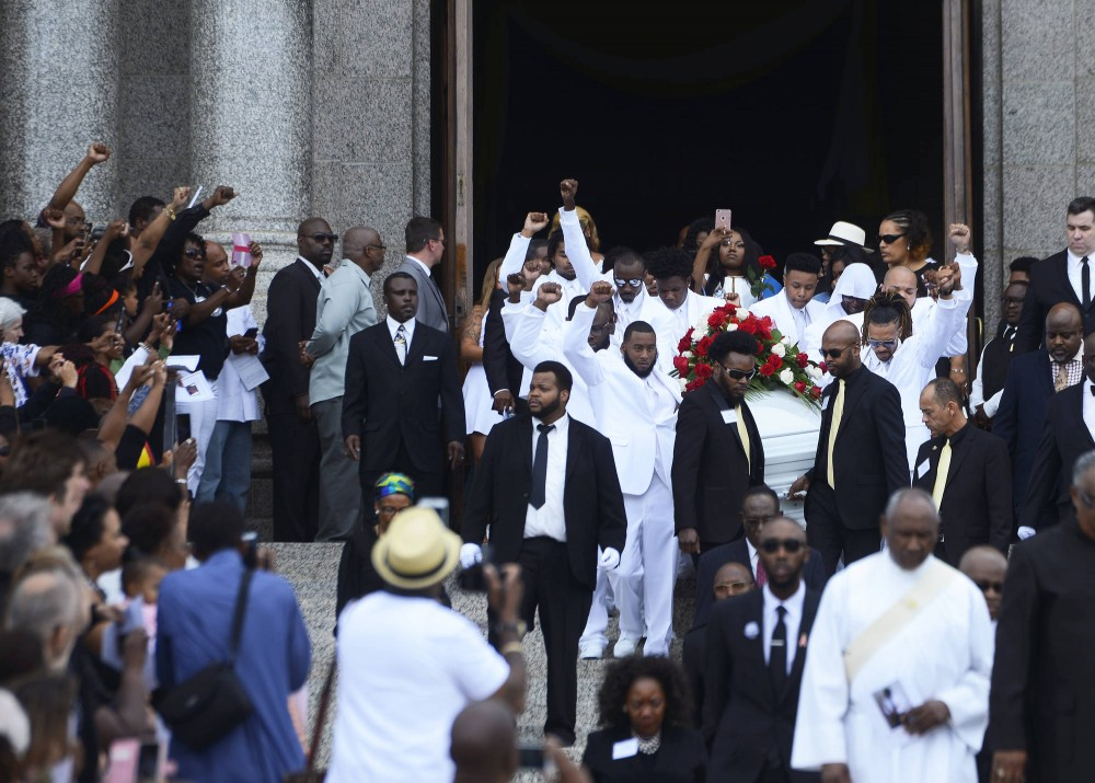 Pallbearers and mourners raise their fists in solidarity as Philando Castile's casket is carried out of the Cathedral of St. Paul following his funeral on Thursday, July 14.