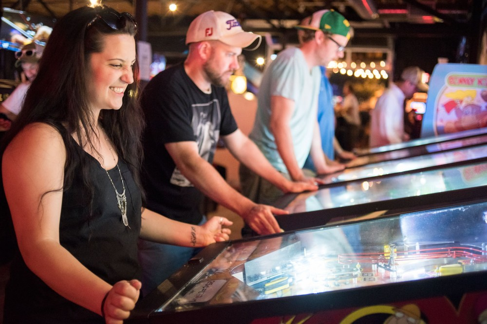 Jenn Truchon-Kelzenber of Blaine plays a Family Guy themed pinball machine at the Up Down bar in Uptown Minneapolis on Sunday evening.