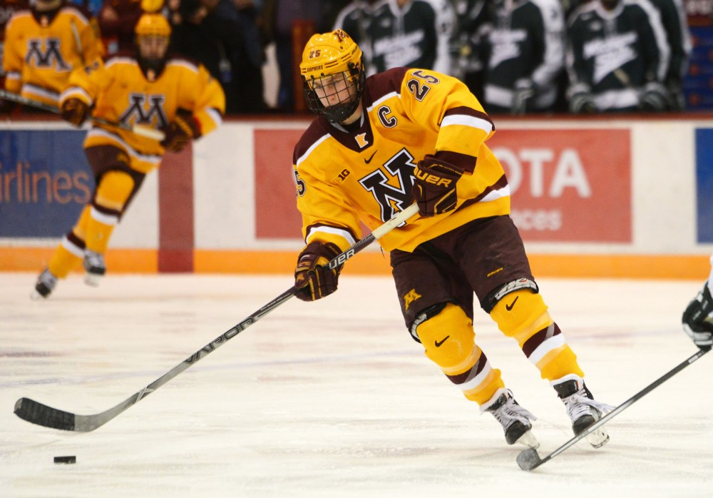 Gophers forward Justin Kloos handles the puck at Mariucci Arena on Jan. 16, 2015.