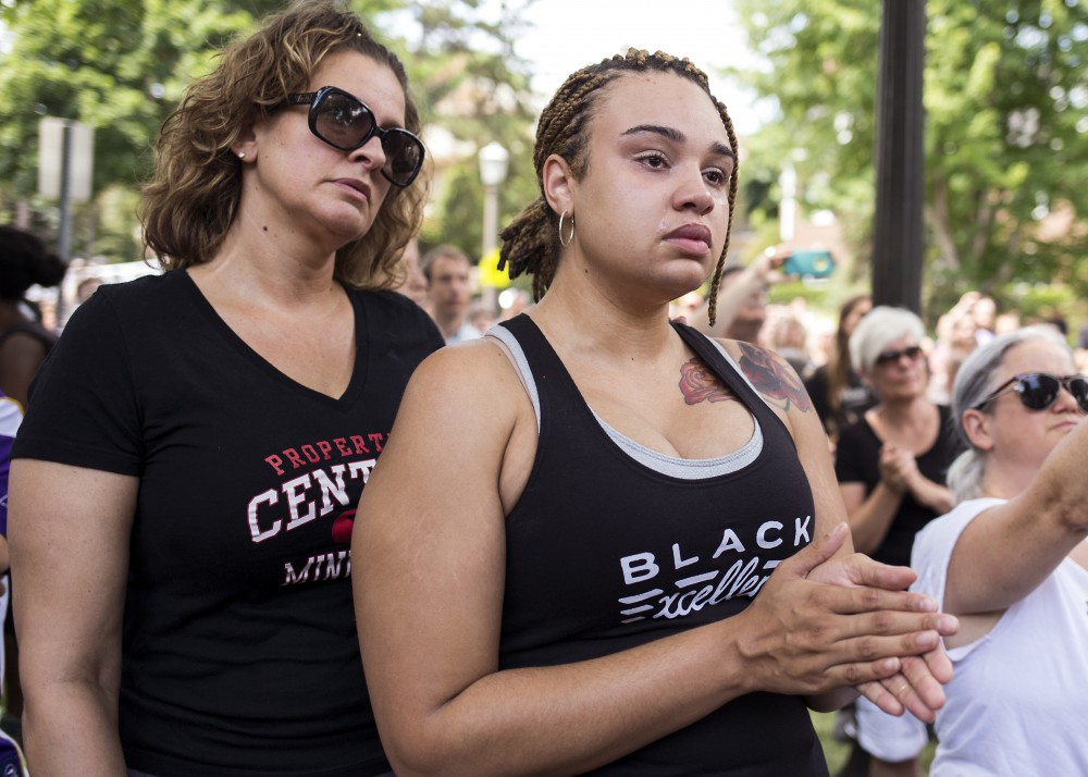 Nikki Moore and her mother Wendy listen to speakers outside of the Minnesota Governor's residence on Thursday, July 7.