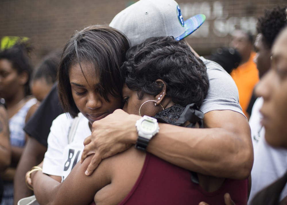 Valerie Castile, mother of Philando Castile, is embraced after speaking outside of J.J. Hill Montessori School in St. Paul on Thursday. Castile was an employee of the school, where he worked as a cafeteria supervisor.