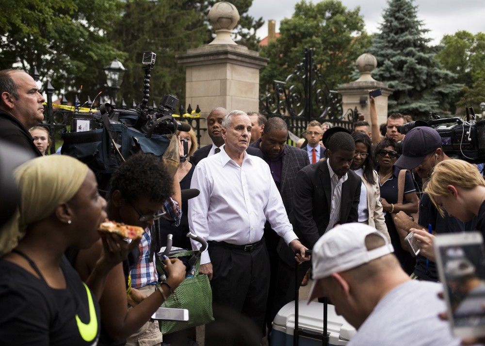 Minnesota Governor Mark Dayton emerged briefly from his residence, where community members gathered on Thursday and spoke personally with the family of Philando Castile.