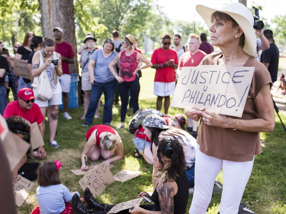 Black Lives Matter supporter Judy Candell holds up a homemade sign in support of Philando Castile at a rally in Loring Park on Saturday.