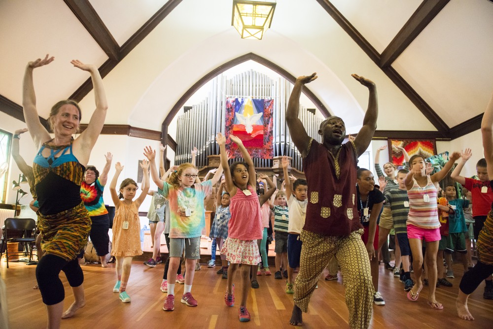 Campers are taught dance moves at All in the Circle Nature Camp at Prospect Park United Methodist Church on Monday morning. The camp, offered to kids in first through eighth grade, aims to connect children with nature and create a culture of kindness.