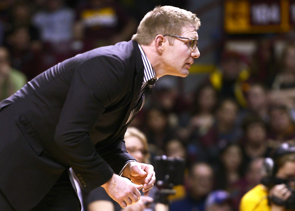 Brandon Eggum coaches from the sidelines during Minnesota's dual against Iowa State at Williams Arena, April 19, 2016.